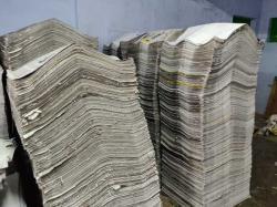 Over Issued or Unused Newspaper